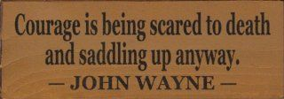 Courage is being scared to death and saddling up anyway. ~ John Wayne Wooden Sign   Decorative Signs