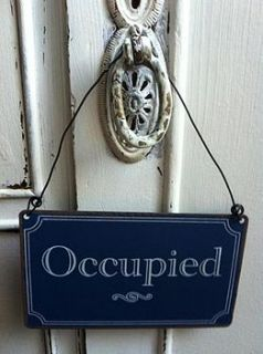 'occupied/vacant' metal sign by the hiding place