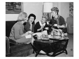 Four young women sitting together drinking tea Poster Print (24 x 36)